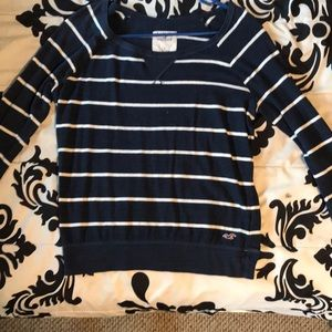 Long sleeved, navy blue/white Hollister top.